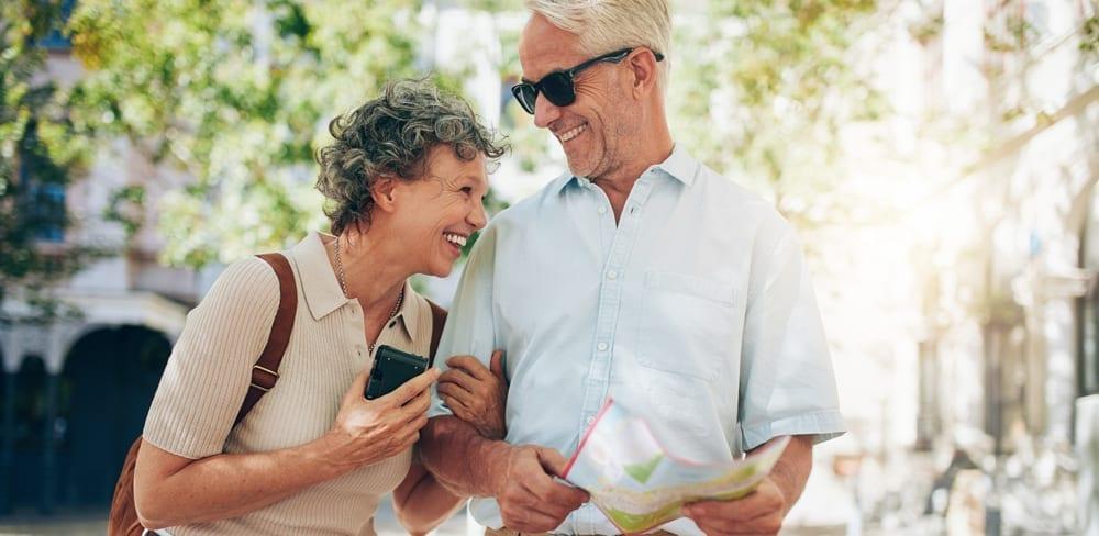 traveling retired couple walks around town life insurance