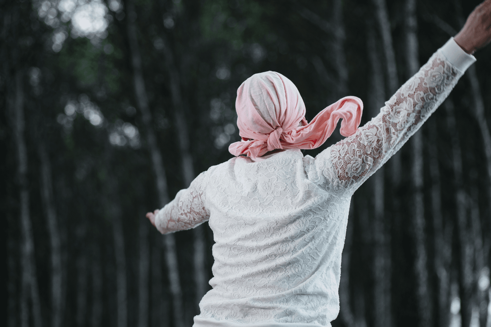 woman with cancer dancing in forest