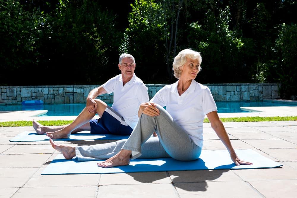 healthy senior citizens doing yoga