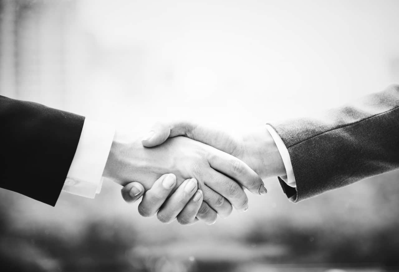 black and white shaking hands business deal