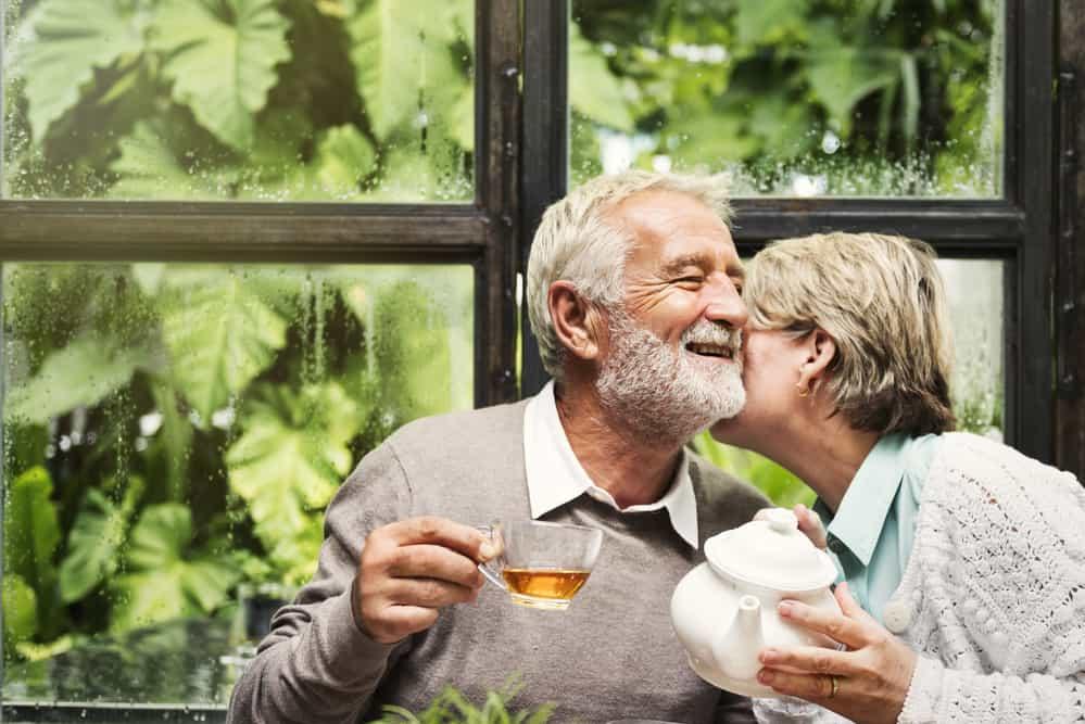 kissing couple tea time rainy day