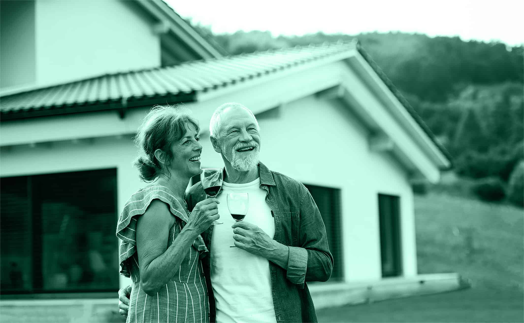 Woman and Man holding wine in front of home